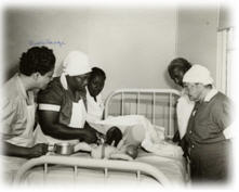 Midwives around a bed