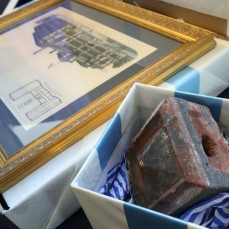 Ornamental brick from old library on display