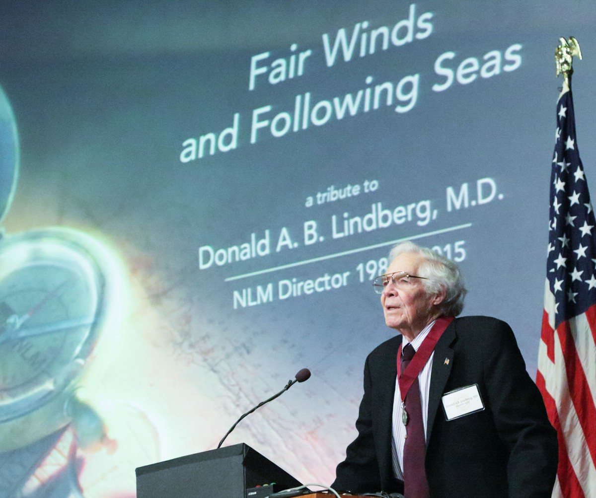 Dr. Lindberg at podium speaks at NIH farewell tribute