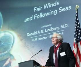 Dr. Lindberg at podium speaks at NIH farewell tribute