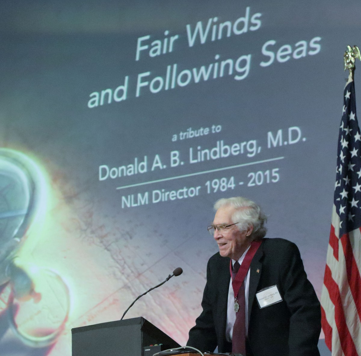 Dr. Lindberg addresses audience at NIH Tribute