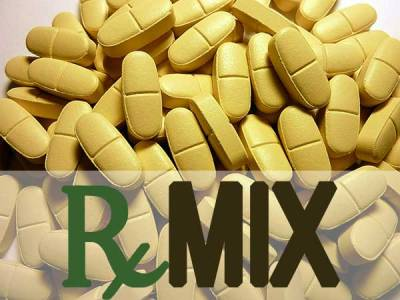 "A pile of unmarked golden-yellow tablets with the text ""RxMIX"" overlayed along the bottom edge"