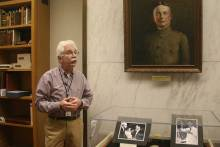 Inside the HMD Incunabula Room, and under the watchful gaze of Dr. Fielding Garrison, acclaimed medical historian and Principal Assistant Librarian (1912-1917) of the Army Medical Library, an NLM antecedent, Dr. Greenberg shows guests the Nobel Medal won by the late Dr. Marshall Nirenberg, and related photographs.