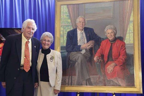 Don and Mary Lindberg stand next to their portrait.