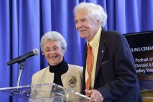 Don and Mary Lindberg stand at the podium.
