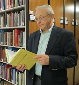 Walter Cybulski looks at a book
