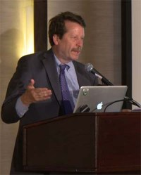 Dr. Califf speaks at a podium.