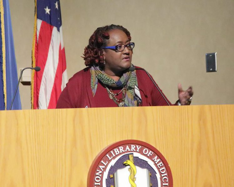 Dr. Williams-Forson speaking from behind a podium