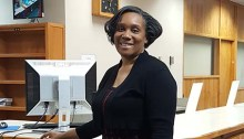 Wanda Whitney in front of NLM's circulation desk