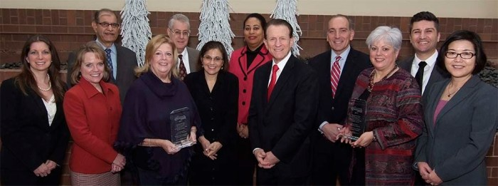 Winners of community outreach award stand together