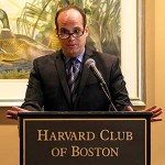 Dr. Mandl speaks at the podium in the Harvard Club of Boston