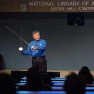 Dr. Yoo holds two fencing swords
