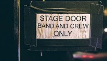 """Sign taped to stage door reads, """"Band and crew only."""""""