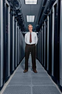 Ostell stands between two banks of servers