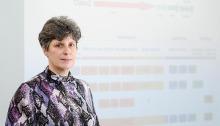 Dr. Makarova in front of a presentation slide