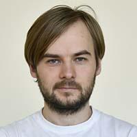headshot of Sergey Shmakov
