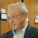 casual headshot of Walter Cybulski looking downward