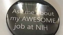 "black button with white letters reading, ""Ask me about my AWESOME job at NIH"""