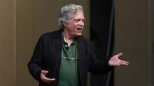 Dr. Alan Curtis Kay gestures as he speaks