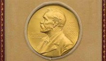 The face of the Nobel Prize medallion shows the profile of Alfred Nobel