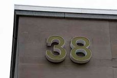"a very large ""38"" on the side of the NLM building"