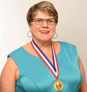 formal headshot of Dr. Patricia Flatley Brennan with the Collen Award medallion draped around her neck