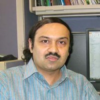 casual headshot of Dr. Aravind Iyer in his office