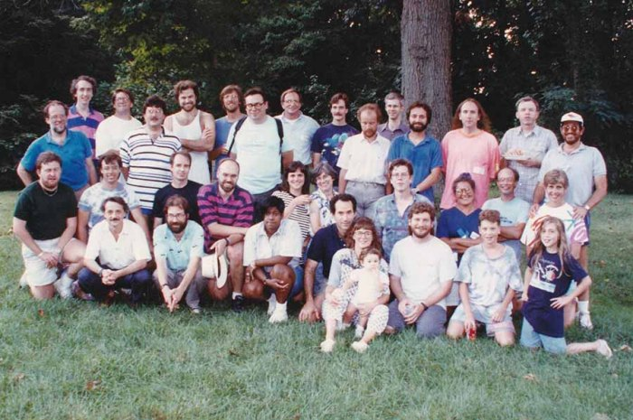 a large group photo taken outdoors in the summer