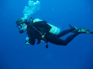 Schneider in full scuba gear underwater