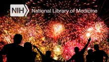 Fireworks exploding with people in the foreground and National Library of Medicine text at the top.